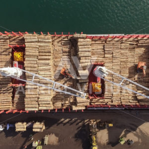 Log ship loading at Northport, Marsden Point - Aerial Vision Stock Imagery
